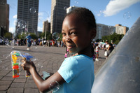 BLOWING BUBBLES AT HART PLAZA, AFRICAN WORLD FESTIVAL 2011